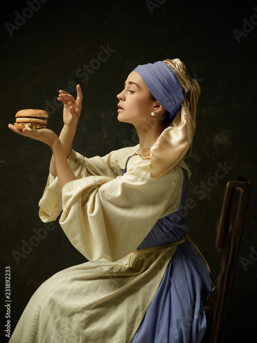 Obraz na plátně Medieval Woman in Historical Costume Wearing Corset Dress and Bonnet with burger