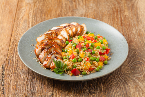 Grilled chicken breast in teriyaki sauce. Served with brown rice and vegetables.