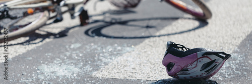 Panorama and close-up on helmet and bicycle on crosswalk after traffic accident Fototapeta
