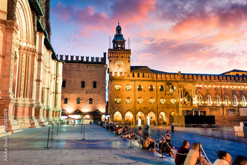 Fototapeta Colorful spring sunset on the main square of City of Bologna with Palazzo d'Accursio and facade of Basilica di San Petronio