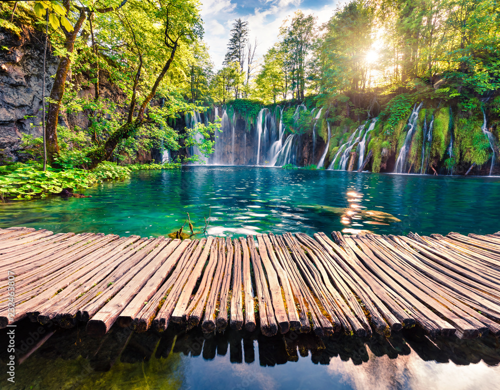 Picturesque morning view of Plitvice National Park. Colorful spring scene of green forest with pure water waterfall. Great countryside landscape of Croatia, Europe.