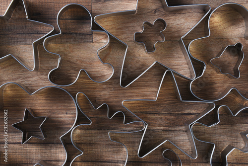 Closeup overhead view of a group of assorted cookie cutters