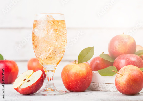 Tablou Canvas Glass of homemade organic apple cider with fresh apples in box on wooden backgro