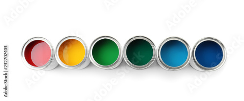 Row of paint cans on white background, top view