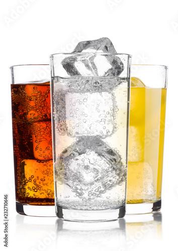 Glasses of cola and orange soda drink and lemonade