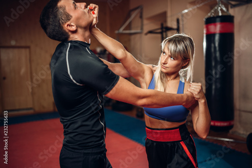 Female person on self-defense workout with trainer