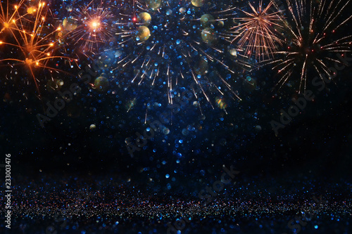 abstract gold, black and blue glitter background with fireworks. christmas eve, 4th of july holiday concept.