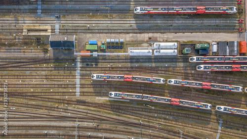 Obraz na plátně Trains at railroad yard at station district