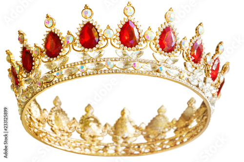 Golden crown with red and white diamonds.  Gold tiara for princess. Expensive jewelry. Decoration for king or queen, magic crown isolated on white background, close up