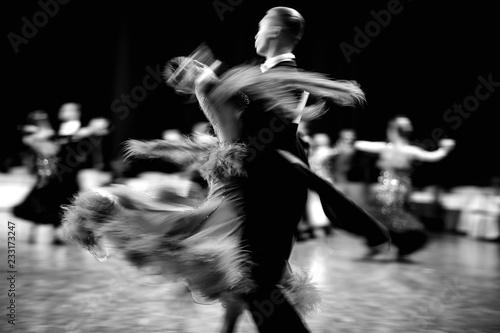 Billede på lærred ballroom dance couple dancers waltz blurred motion black-and-white