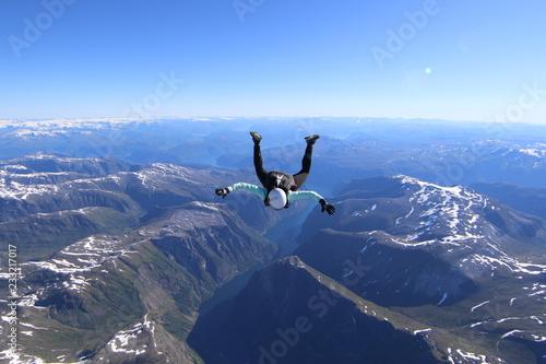 Obraz na plátně Wingsuti skydiving over Norway