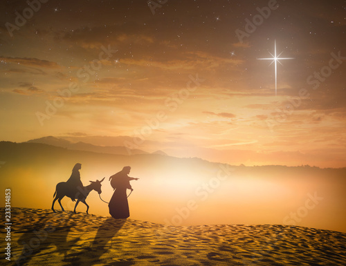Foto Nativity Christmas concept: Silhouette pregnant Mary and Joseph with a donkey on