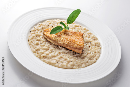 Dish of Parmesan risotto with fish fillet