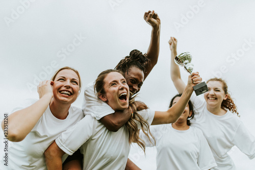Female football players celebrating their victory Fototapeta