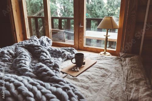 Fotografija Cozy winter weekend in log cabin