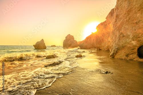 Scenic El Matador State Beach, California, United States. Sunset lights between pillars and boulder of most photographed Malibu beach, Pacific Ocean. Beautiful sunset on California sea, West Coast.