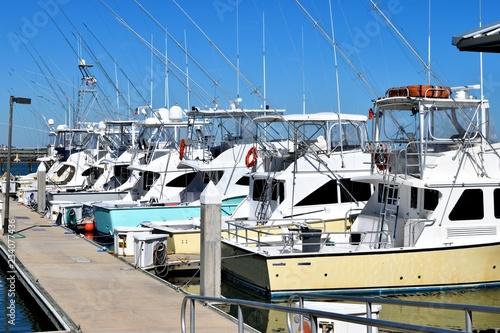 Fotografia Sport fishing boats moored at marina dock St. Augustine, Florida