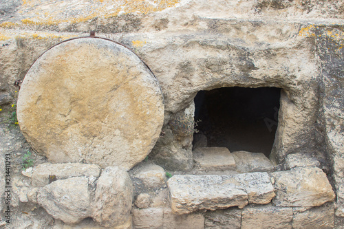 Photo A typical rock hewn sepulchre on the road to Megiddo in Israel