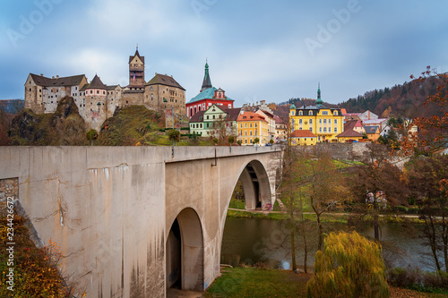Fotografie, Obraz Colorful town and Castle Loket over Eger river in the near of Karlovy Vary, Czec