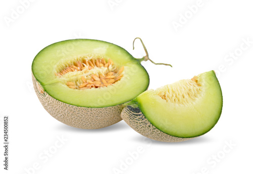 Canvas Print half and portion cut ripe sweet honeydew green melon on white background