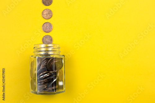 Slika na platnu Coins with glass jar for money saving financial