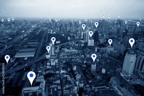 aerial view of skyscraper city with sign of pin map