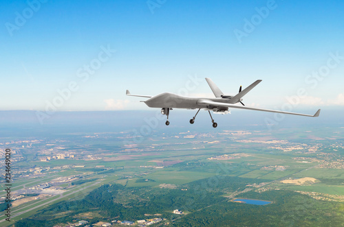 Unmanned military drone uav on patrol air territory at low altitude.