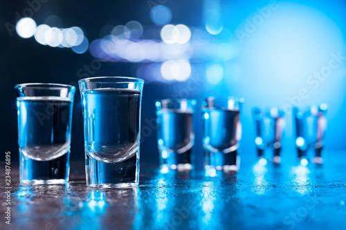 Glasses of Vodka lit with blue backlight.