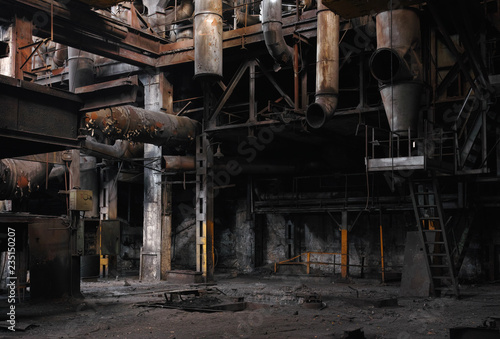 Half-ruined metal structures in an old abandoned car factory.