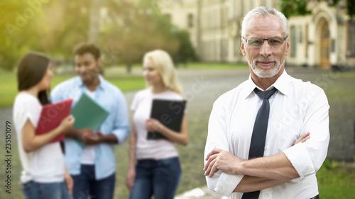 Fotografia Successful professor posing with hands crossed, university education, future
