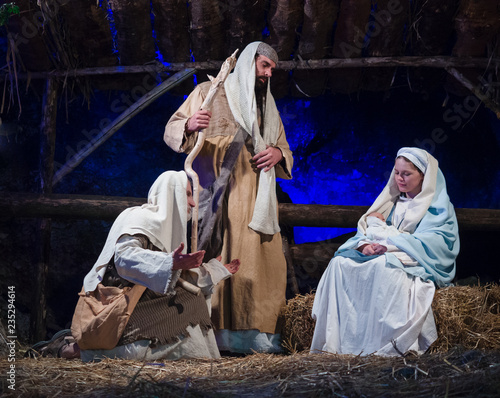 Fotografie, Obraz Representation of the nativity recreating the famous paintings of Giotto and Caravaggio