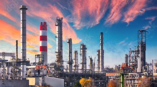 Canvas Print Pipeline and pipe rack of petroleum industrial plant with sunset sky background