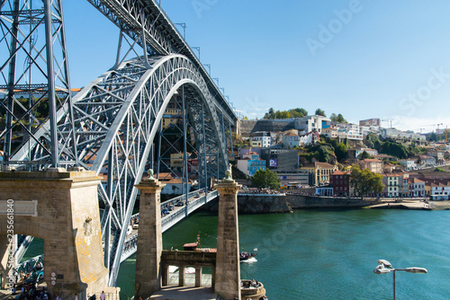 Panoramic landscape view on the old town with Douro river and famous iron bridge in Porto city in Portugal