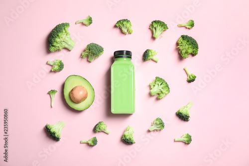 Flat lay composition with smoothie in bottle and ingredients on color background