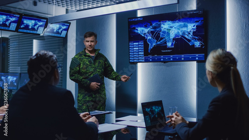 Fotografiet High-Ranking Military Man holds a Briefing to a Team of Government Agents and Politicians, Shows Satellite Surveillance Footage