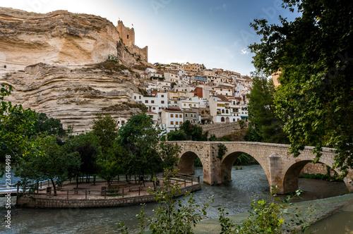 Bridge over the river Júcar with the castle on the rocks in Alcalá del Júcar in Albacete, Spain