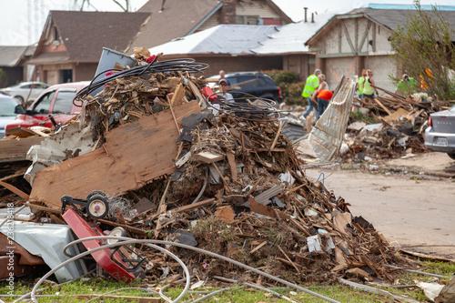 Fototapeta Debris Piled Up During Tornado Destruction Cleanup