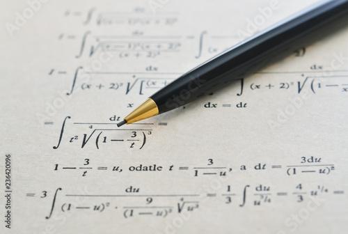 Pencil and math book