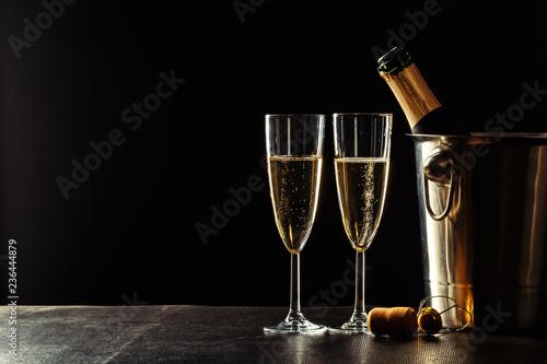 Obraz na płótnie Champagne on the black background