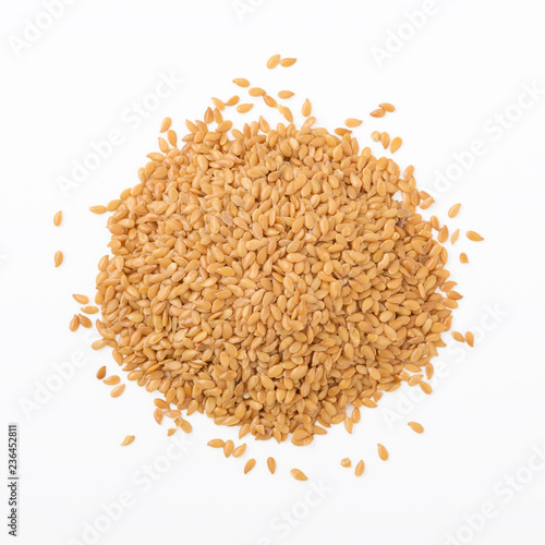 Golden flaxseed isolated on white background, top view