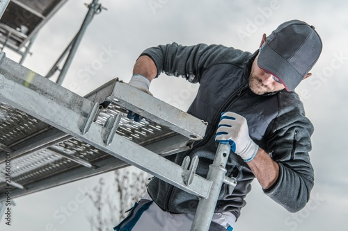 Canvas Print Worker Installing Scaffolding