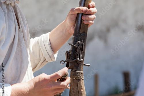 Fototapeta Antique gun in a hand