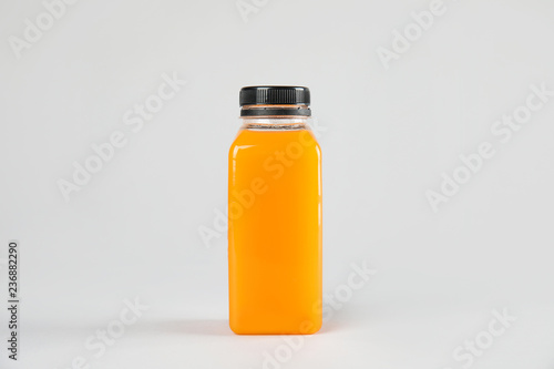 One bottle with tasty drink on color background
