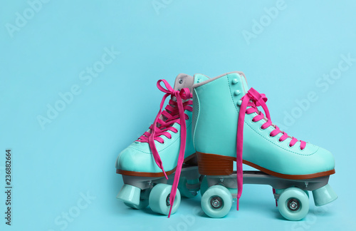 Fototapeta Pair of stylish quad roller skates on color background