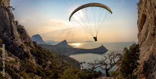 Fotografiet flying on paraplane