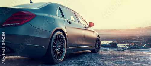 Luxury car parked on a mountain. 3D render and illustration.