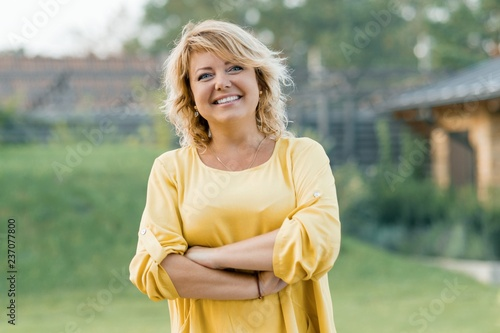 Fotografija Outdoor portrait of positive confident mature woman