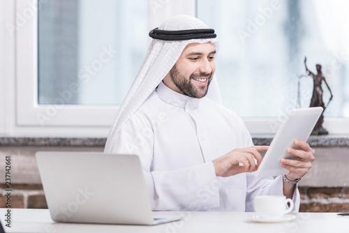 Arabian businessman using digital tablet in office Tapéta, Fotótapéta