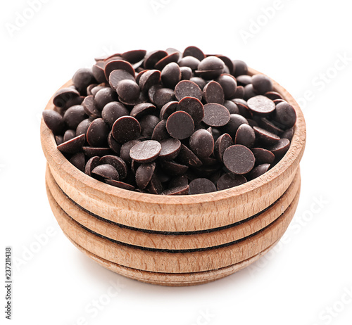 Fototapeta Wooden bowl with delicious dark chocolate chips on white background