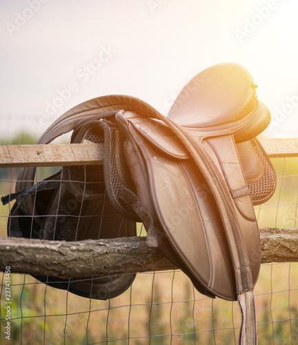 Canvas-taulu Old horse saddle on a fence
